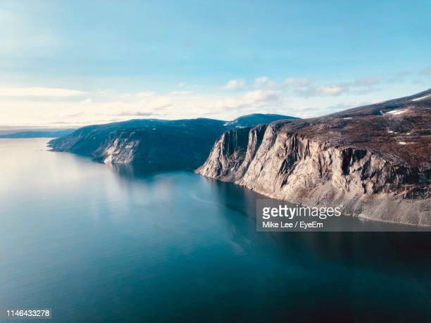 panoramic view of sea and mountains against sky - baffin island stock pictures, royalty-free photos & images