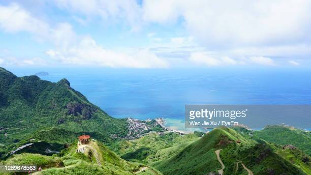 panoramic view of sea and mountains against sky - taiwan stock pictures, royalty-free photos & images