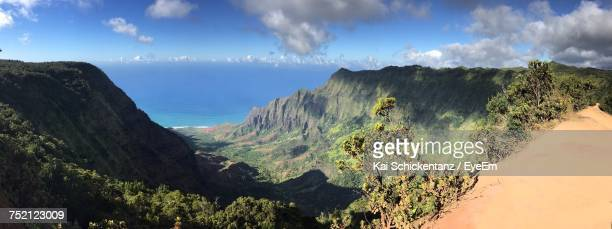 panoramic view of sea and mountains against sky - hawaii volcanoes national park stock pictures, royalty-free photos & images