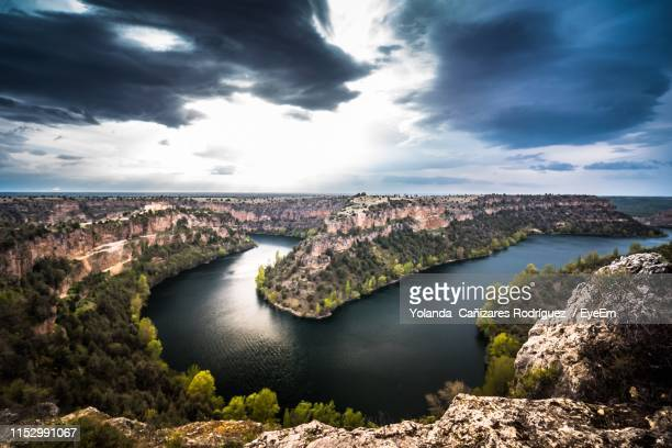 panoramic view of sea and rocks against sky - segovia stock pictures, royalty-free photos & images