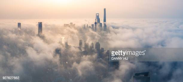panoramic view of shanghai city over the advection fog at sunrise - inquinamento foto e immagini stock