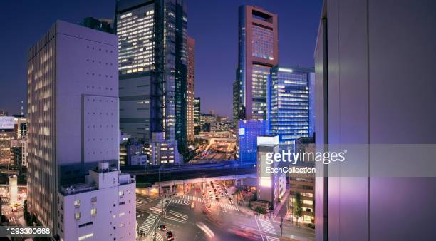 panoramic view of shiodome business district in tokyo, japan, at dusk - tokyo japan stock pictures, royalty-free photos & images