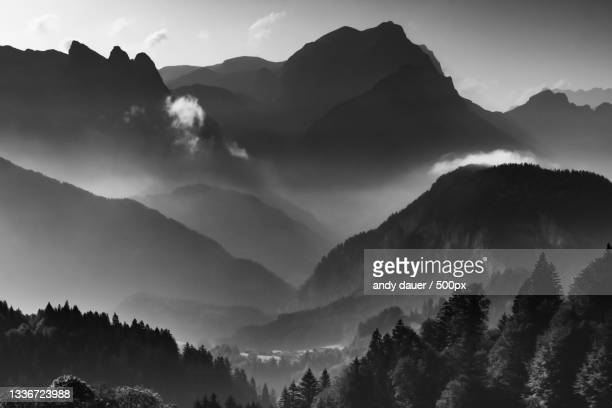 panoramic view of silhouette of mountains against sky - andy dauer stock pictures, royalty-free photos & images