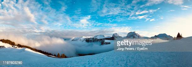 "panoramic view of snow covered mountains against sky - ""jörg peters"" stock-fotos und bilder"