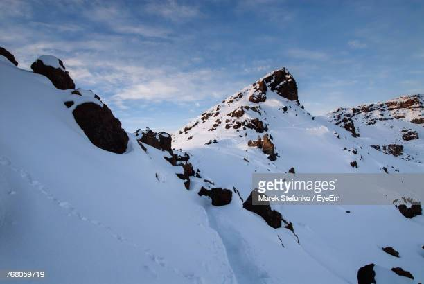 panoramic view of snowcapped mountain against sky - marek stefunko stock photos and pictures