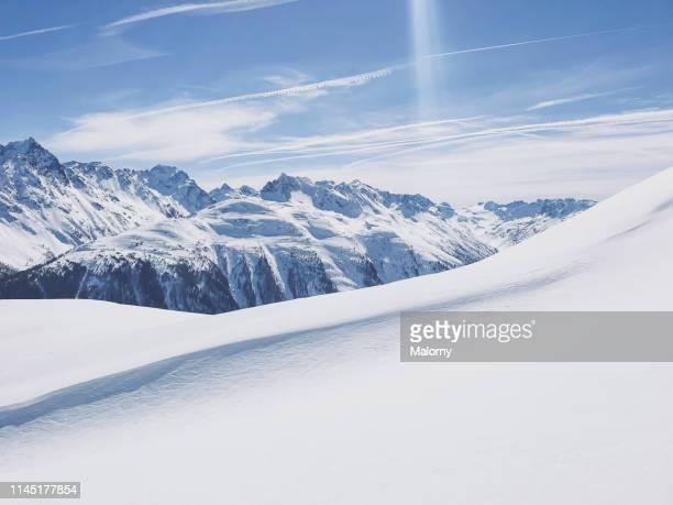 panoramic view of snowcapped mountain range. - mountain range ストックフォトと画像