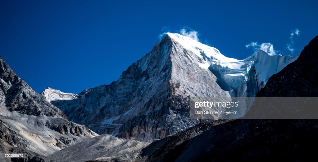 Panoramic View Of Snowcapped Mountains Against Clear Blue Sky : Stock Photo