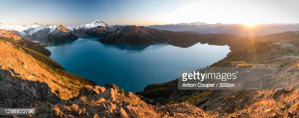 panoramic view of snowcapped mountains against sky during sunset,garibaldi lake,canada - wasser stock pictures, royalty-free photos & images