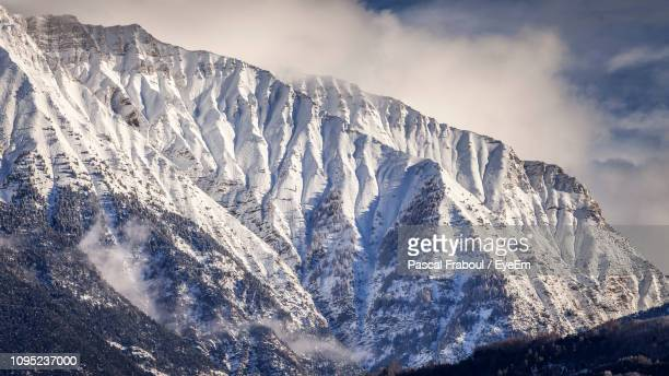 panoramic view of snowcapped mountains against sky - embrun stock pictures, royalty-free photos & images