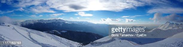 panoramic view of snowcapped mountains against sky - sochi stock pictures, royalty-free photos & images