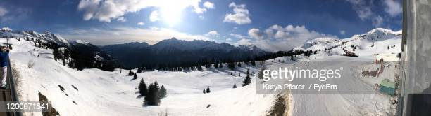 panoramic view of snowcapped mountains against sky - cari stock pictures, royalty-free photos & images