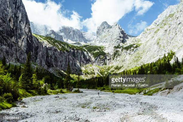 panoramic view of snowcapped mountains against sky - hochplateau stock-fotos und bilder