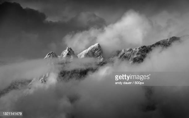 panoramic view of snowcapped mountains against sky - andy dauer stock pictures, royalty-free photos & images