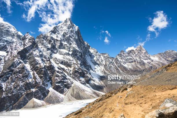 panoramic view of snowcapped mountains against sky - didier marti stock photos and pictures