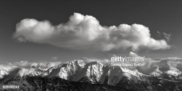 panoramic view of snowcapped mountains against sky - sandra gygax stock-fotos und bilder