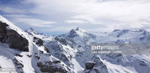 panoramic view of snowcapped mountains against sky - deep snow stock pictures, royalty-free photos & images