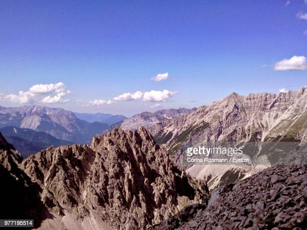 panoramic view of snowcapped mountains against sky - corina rissmann stock-fotos und bilder
