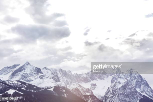 Panoramic view of snowy mountains at Zugspitze. Zugspitze, Bavaria, Germany. Amateur Winter Sports