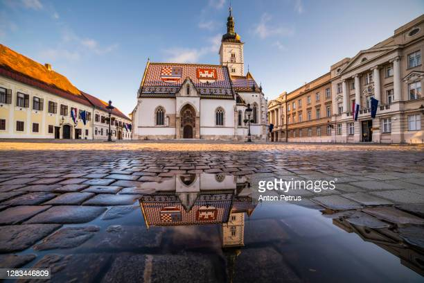 panoramic view of st. mark's church at sunrise, zagreb, croatia - croatia stock pictures, royalty-free photos & images