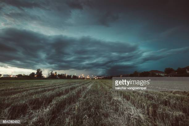 panoramic view of storm over the farm - nuvoloso foto e immagini stock