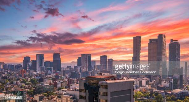 panoramic view of sunrise in mexico city from high above - mexico stad stockfoto's en -beelden