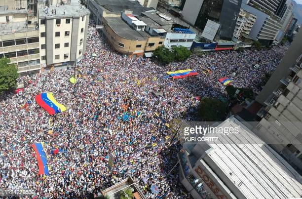 Panoramic view of supporters of Venezuelan opposition leader and self declared acting president Juan Guaido during a rally to press the military to...