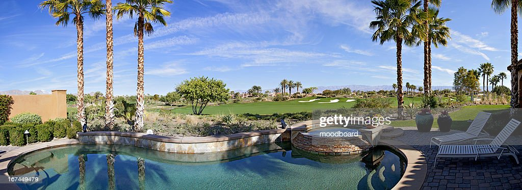 Panoramic view of swimming pool, hot tub and golf course : Stock Photo