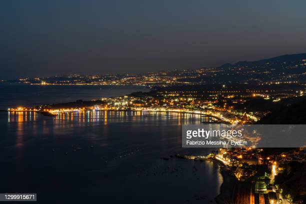 panoramic view of taormina coast. view from villa comunale - fabrizio villa stock pictures, royalty-free photos & images
