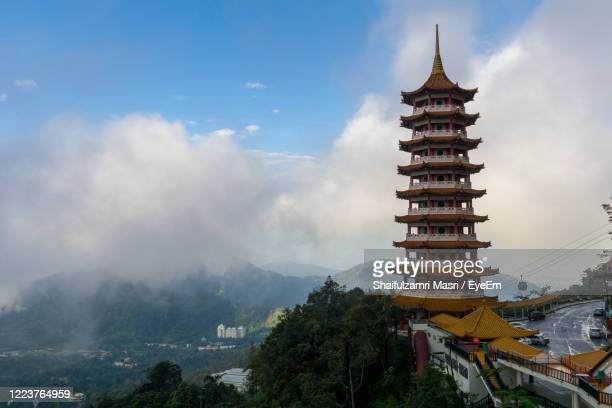 panoramic view of temple against sky - shaifulzamri stock pictures, royalty-free photos & images