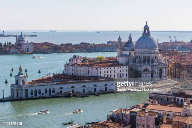a panoramic view of the basilica di santa maria della salute - venice, italy - punta della dogana stock photos and pictures
