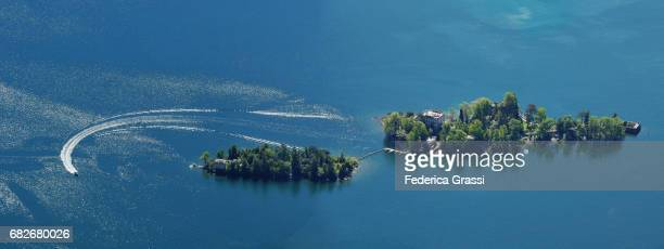 panoramic view of the brissago islands, lake maggiore, switzerland - ascona stock photos and pictures