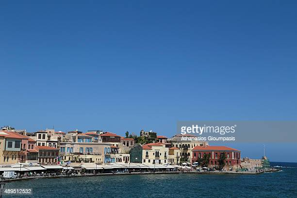 Panoramic view of the Chania Venetian harbour with its lighthouse is the trademark of the city of Chania on July 16 2015 in Chania Greece The...