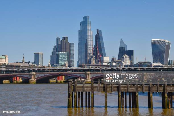 Panoramic view of the City of London skyline, Blackfriars Railway Bridge and River Thames on a clear day.