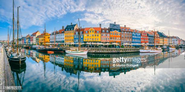panoramic view of the colorful houses in nyhavn, copenhagen - nyhavn stock pictures, royalty-free photos & images