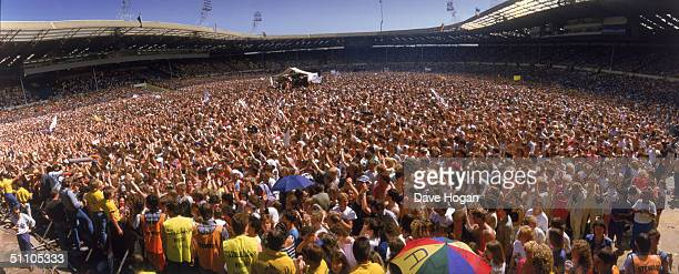 A panoramic view of the crowd at the Live Aid charity concert Wembley Stadium London 13th July 1985