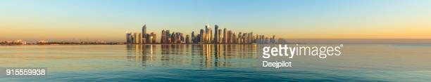 Panoramic View of the Downtown Doha City Skyline at sunset, Qatar