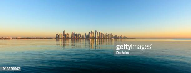 panoramic view of the downtown doha city skyline at sunset, qatar - doha stock pictures, royalty-free photos & images
