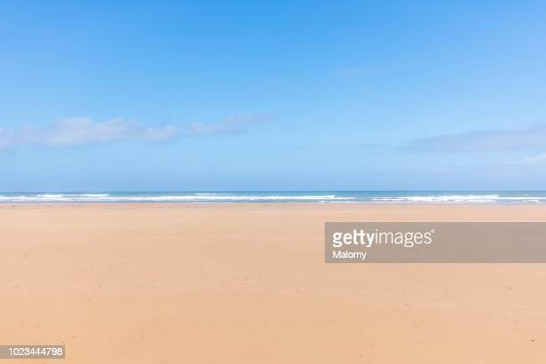 panoramic view of the empty beach and waves. sea in the background. sidi kaouki, morocco. - beach stockfoto's en -beelden