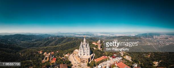 panoramic view of the expiatory church of the sacred heart of jesus - tibidabo stock pictures, royalty-free photos & images