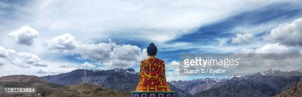 panoramic view of the giant buddha statue at langza, india against the sky - shimla stock pictures, royalty-free photos & images