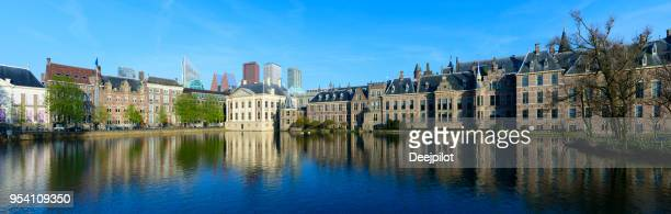 panoramic view of the hague downtown city skyline and parliament buildings netherlands - binnenhof stock photos and pictures