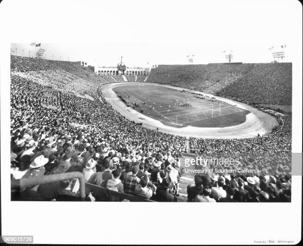 A panoramic view of the inside of the Los Angeles Memorial Coliseum with a capacity crowd Los Angeles California early to mid twentieth century