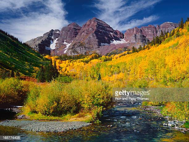 panoramic view of the maroon bells peak with aspen trees - maroon bells stock photos and pictures