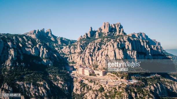 panoramic view of the montserrat gorge. monestir santa maria de montserrat - catalonia stock pictures, royalty-free photos & images