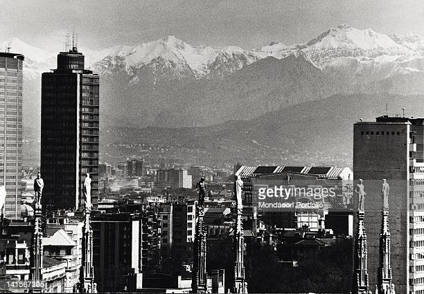 Panoramic view of the mountains from Milan Cathedral's spires Milan 1971