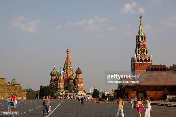 Panoramic view of The Red Square with St Basil Cathedral Moscow Kremlin and Spasskaya Tower on August 05 2010 in Moscow Russia Red Square separates...