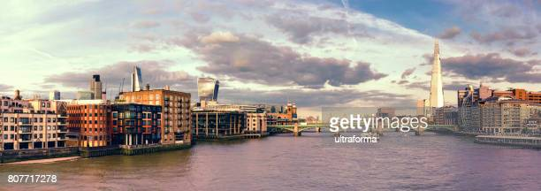 Panoramic view of The Shard, City of London and Southwark Bridge at sunset