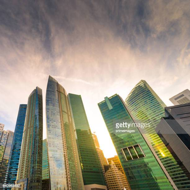panoramic view of the singapore skyline at dusk - merlion park stock photos and pictures