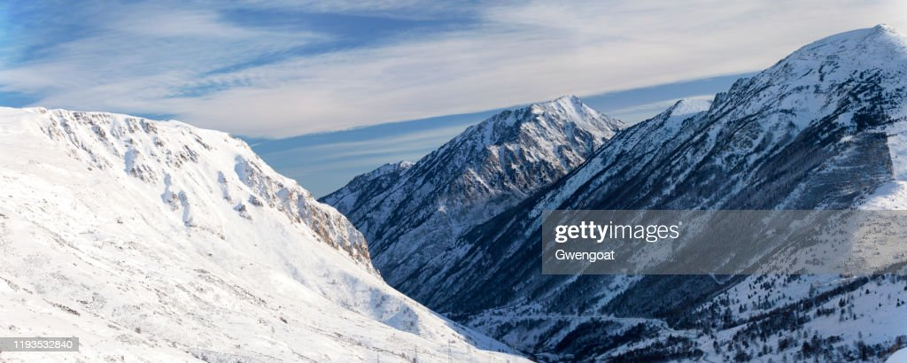 Panoramic view of the snow-capped mountains in the Pyrenees : Stock Photo