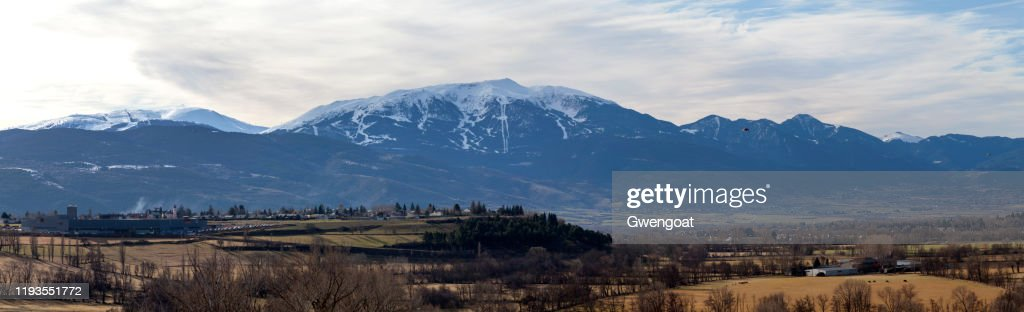 Panoramic view of the snow-capped mountains of Tosa d'Alp and the village of Puigcerdà : Stock Photo